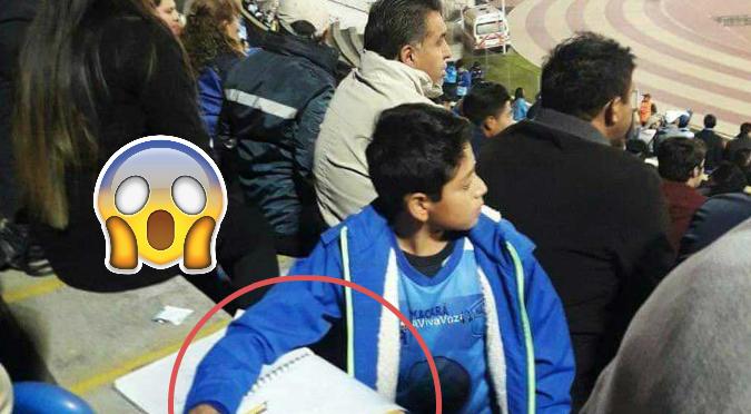 Twitter: Niño se vuelve viral por hacer tarea en el Estadio (FOTOS)