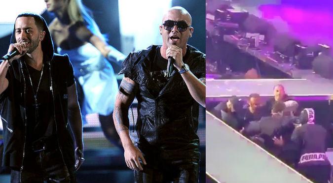 Wisin y Yandel: Cantante sufrió terrible caída del escenario (VIDEO)